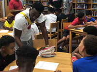 Treston Cook-Lincoln talks with other students