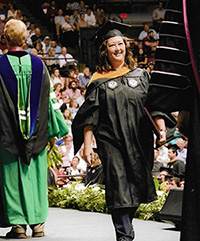 Celeste Kallenborn walking at graduation