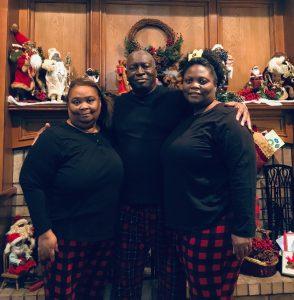 three people in matching pajamas