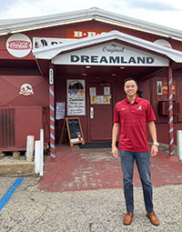 Kevin Quan outside Dreamland BBQ