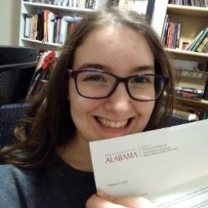 Noella holding her letter of acceptance from UA