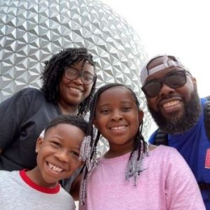 Melanie and her family at Disney World