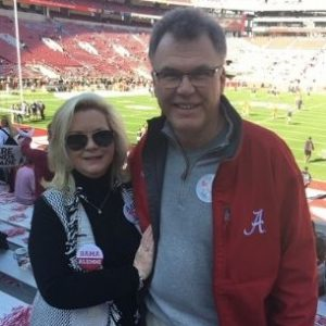 Ron and his wife at an Alabama football game