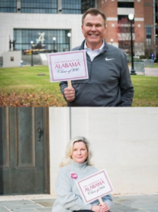 Ron and his wife holding UA signs
