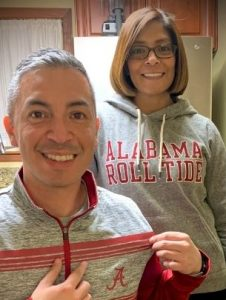 Carlos and his mom in Alabama gear
