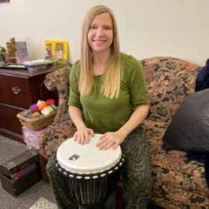 Jessica with a drum from drum therapy