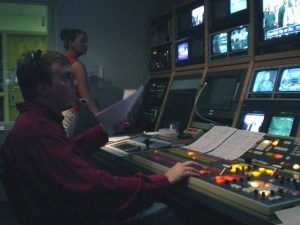 Michael directing a newscast from the newsroom
