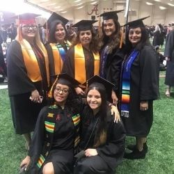 Sonia with a group of graduates from her cohort at graduation