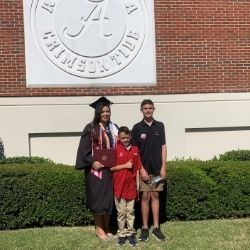 Crystal and her sons at graduation