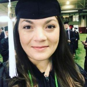 Elizabeth in a graduation cap