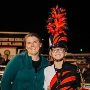 Kimberly with her daughter in her marching band uniform