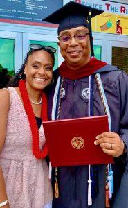 Jay and a family member at graduation