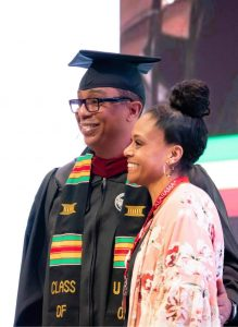 Jay and his wife at graduation