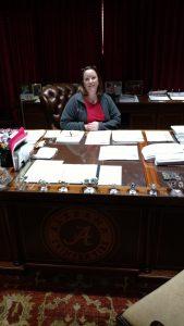 Alyson at her desk at work