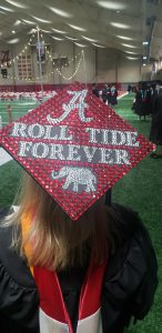 """Tina's mortar board that reads, """"ROLL TIDE FOREVER"""""""